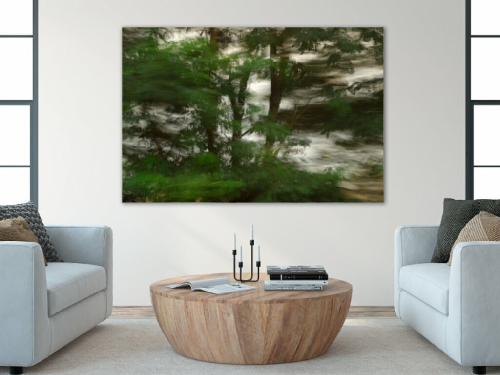 A large photograph of landscape in motion on the wall of a modern yet cozy living room