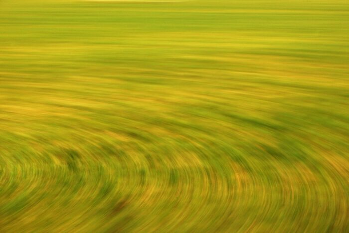 experimental photo art, a field turned into circular lines by motion