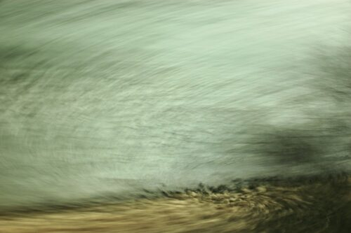 expermental photography, motion blur in a photograpph of a stony riverside