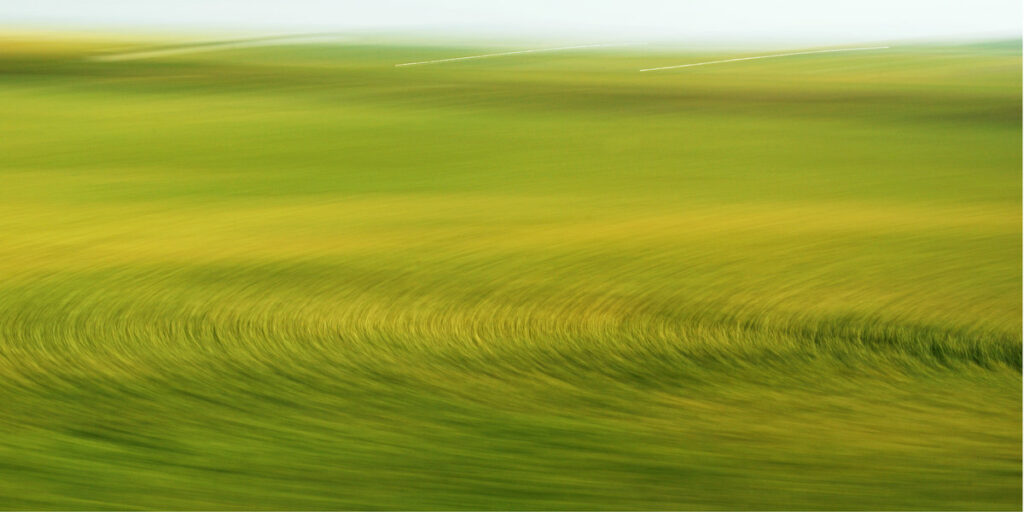 abstract photo art. A field turned into a pattern of circles and lines by motion blur